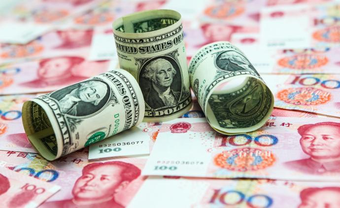美联储释放降息信号,人民币对美元中间价大涨逼近6.88