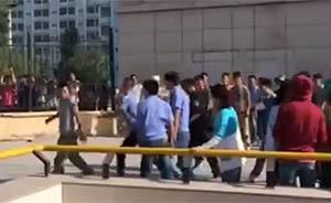 """兰州再次回应""""城管群殴学生"""":一城管手被打骨折"""