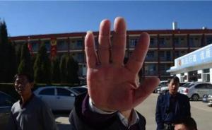 陕西榆阳工商分局办公室主任跳楼:人受重伤,砸坏一辆公车