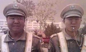 """沙尘暴中的新疆交通协警""""泥哥"""":家人看到照片让我改行"""