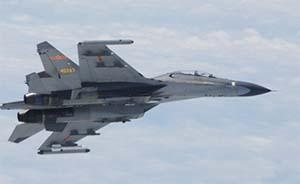日本防卫省:侦察机遭中国苏27战机近距离拦截