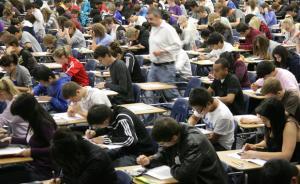 留美中国学生替考案首人认罪:QQ上六千美元雇枪手考GRE