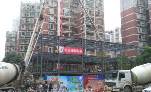 武汉一街道办违建并公然抗法:撕封条、用吊车拖走城管执法车