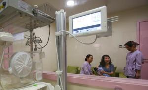"""上海儿童医院新设""""亲子陪护""""病房,允许家长隔着玻璃看宝宝"""