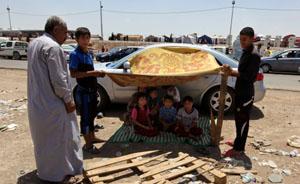 外交笔记|中国应尝试建救援性全球反应力量应对伊拉克危机