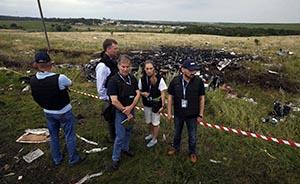 荷英马美四国成立MH17联合调查团,乌民间武装掌控坠机现场