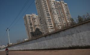 专家解读住宅小区破围墙:现在是物业管大门,未来是管大楼