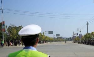套牌车违法变道拒绝检查顶着上海交警开出30米,司机被刑拘