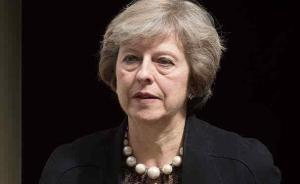 竞争对手退出,现任内政大臣特里莎·梅将成英国第二位女首相