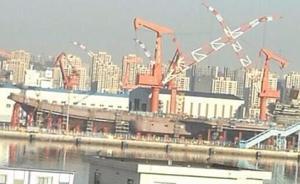 军事专家尹卓:首艘国产航母预计明年年初下水