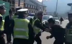 贵州六盘水回应交警打人:系辅警,涉事男子违章并先动手