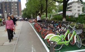 节假日数万共享单车涌入商业区,武汉警方建微信群规范停车