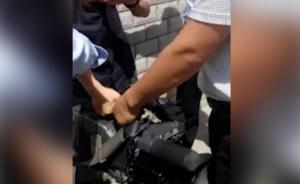 记者车管所采访被打休克:2人被拘