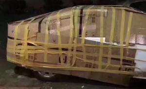 图为6月12日晚,一网友为抵御台风把车包起来。深圳新闻网 图