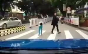 视频丨私家车车主主动在斑马线前停车让行,孩子鞠躬致谢